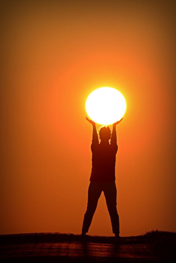 Sonne in der Hand