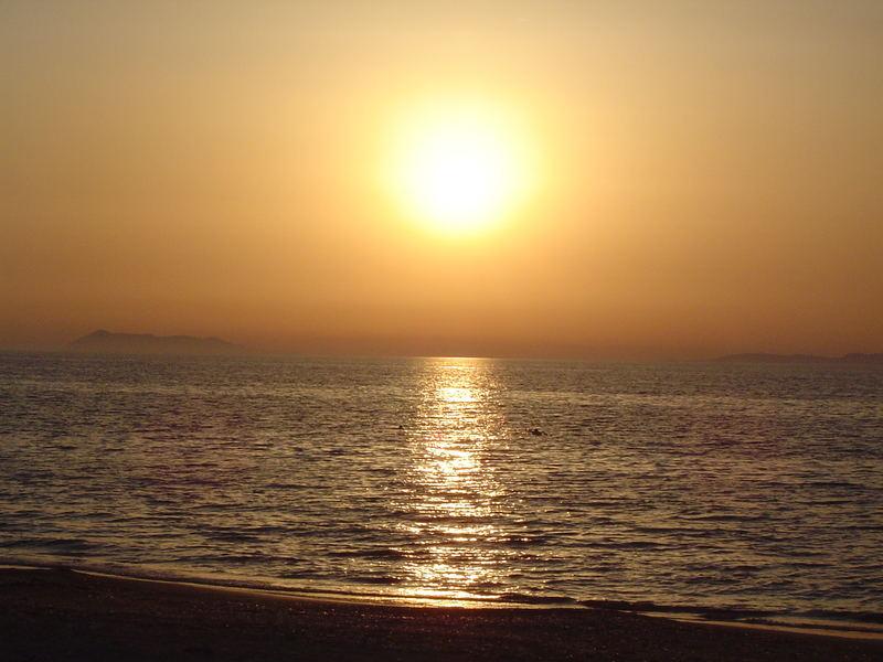 Sonne trifft Meer