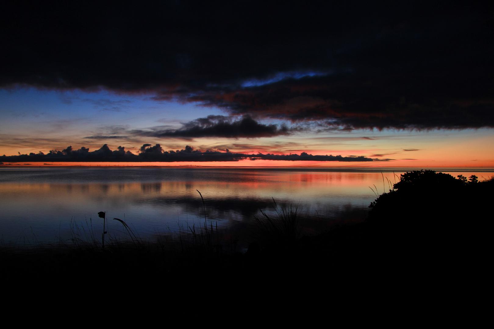 Sonnenaufgang am Fjord