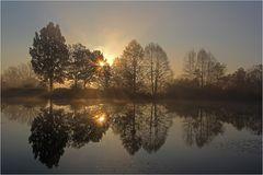 Sonnenaufgang am Weiher