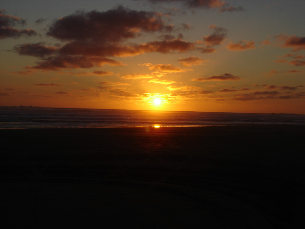 Sonnenuntergang am Nintey Mile Beach Neuseeland