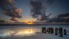 Sonnenuntergang an den Buhnen von Rantum auf Sylt