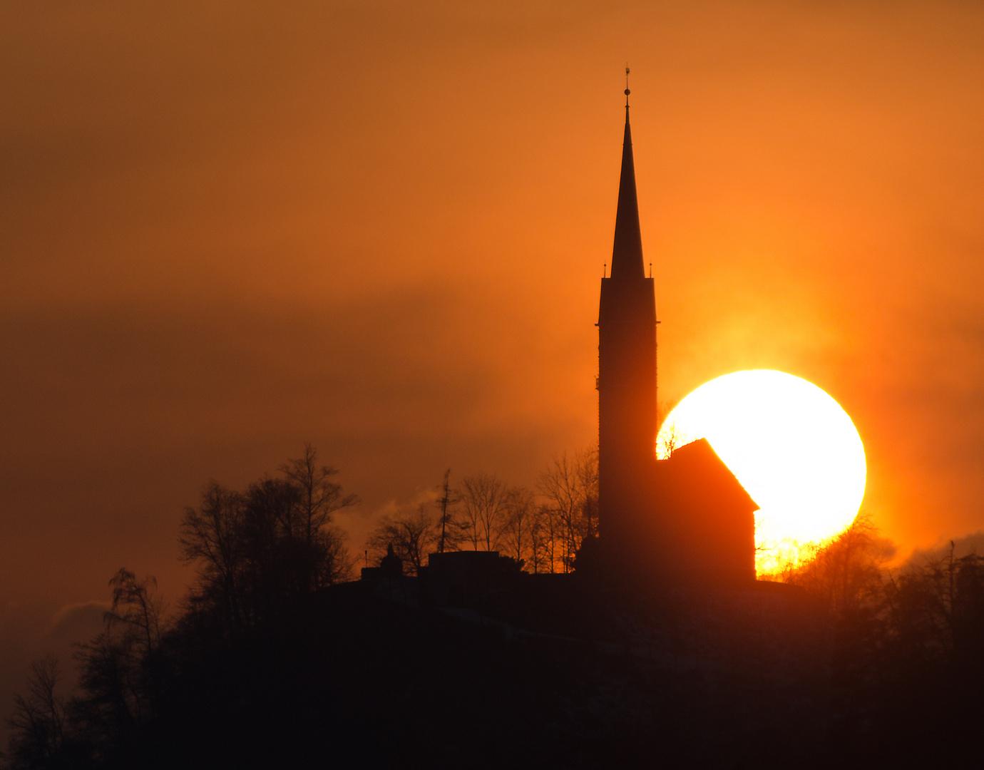 Sonnenuntergang mit Kirche von Tamins