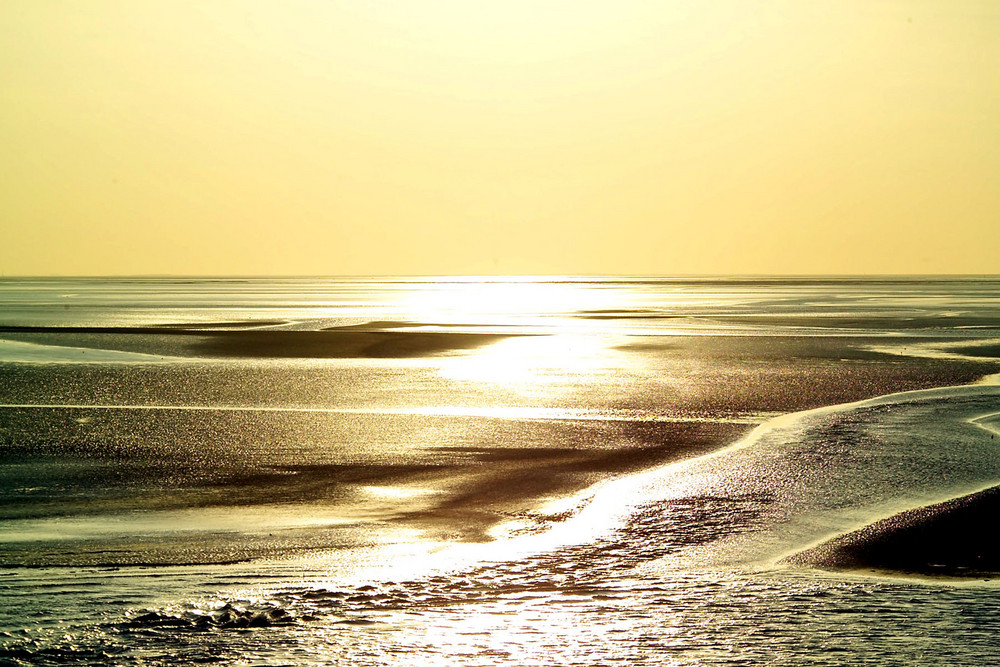 Sonnenuntergang über dem Watt bei Norderney