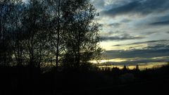 Sonnenuntergang über dem (Weiher-) Feld