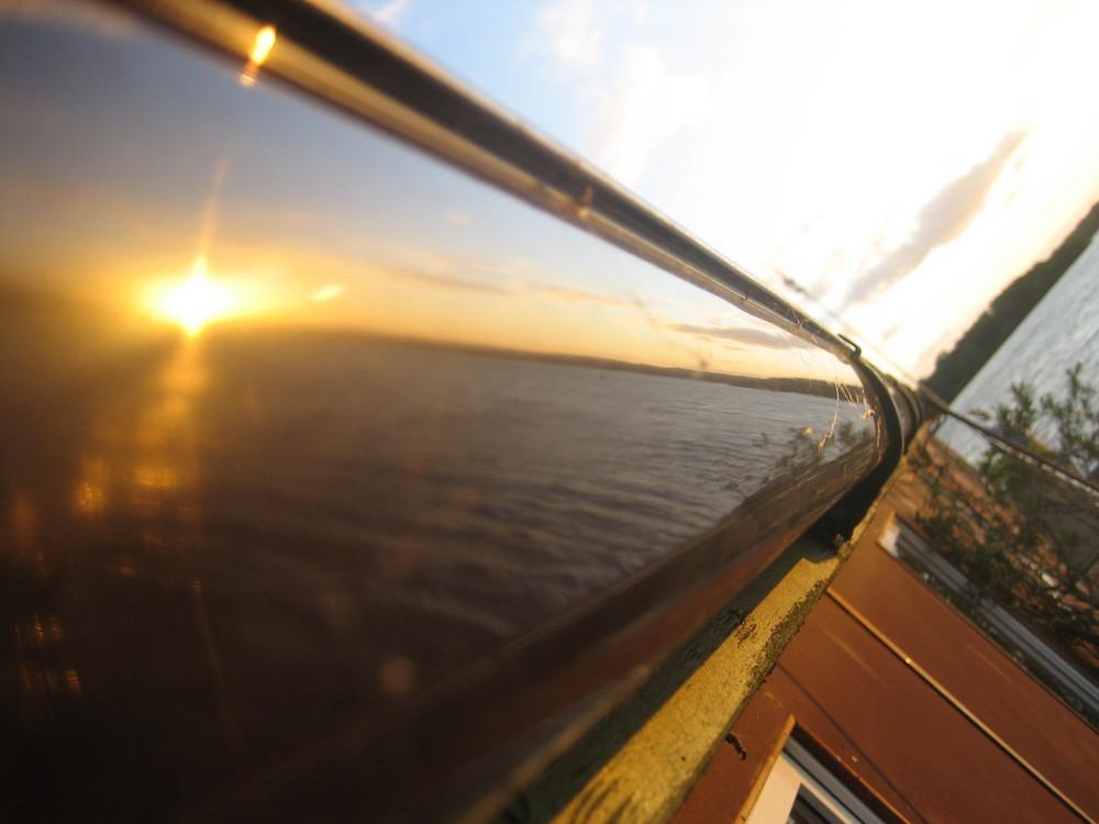 Sonnenuntergangstimmung am Wannsee Spieglung in der Regenrinne
