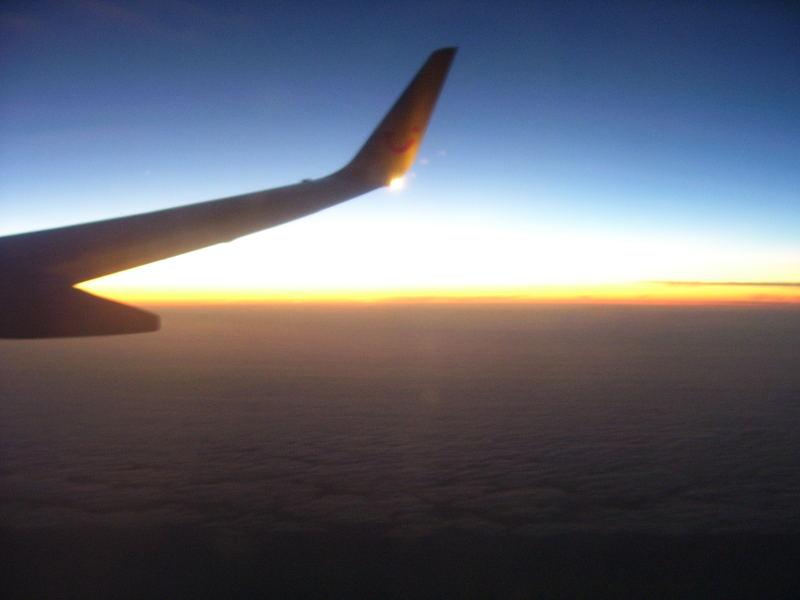 Sonnenunterganz über den Wolken