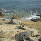 Steine Sand und Meer