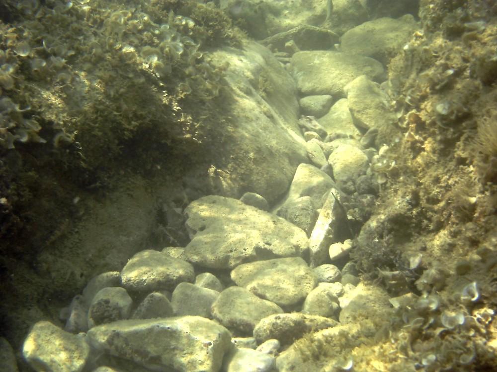 Steinschlag unter Wasser