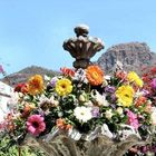 Stone fountain with flowers