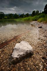 stone in quiet water