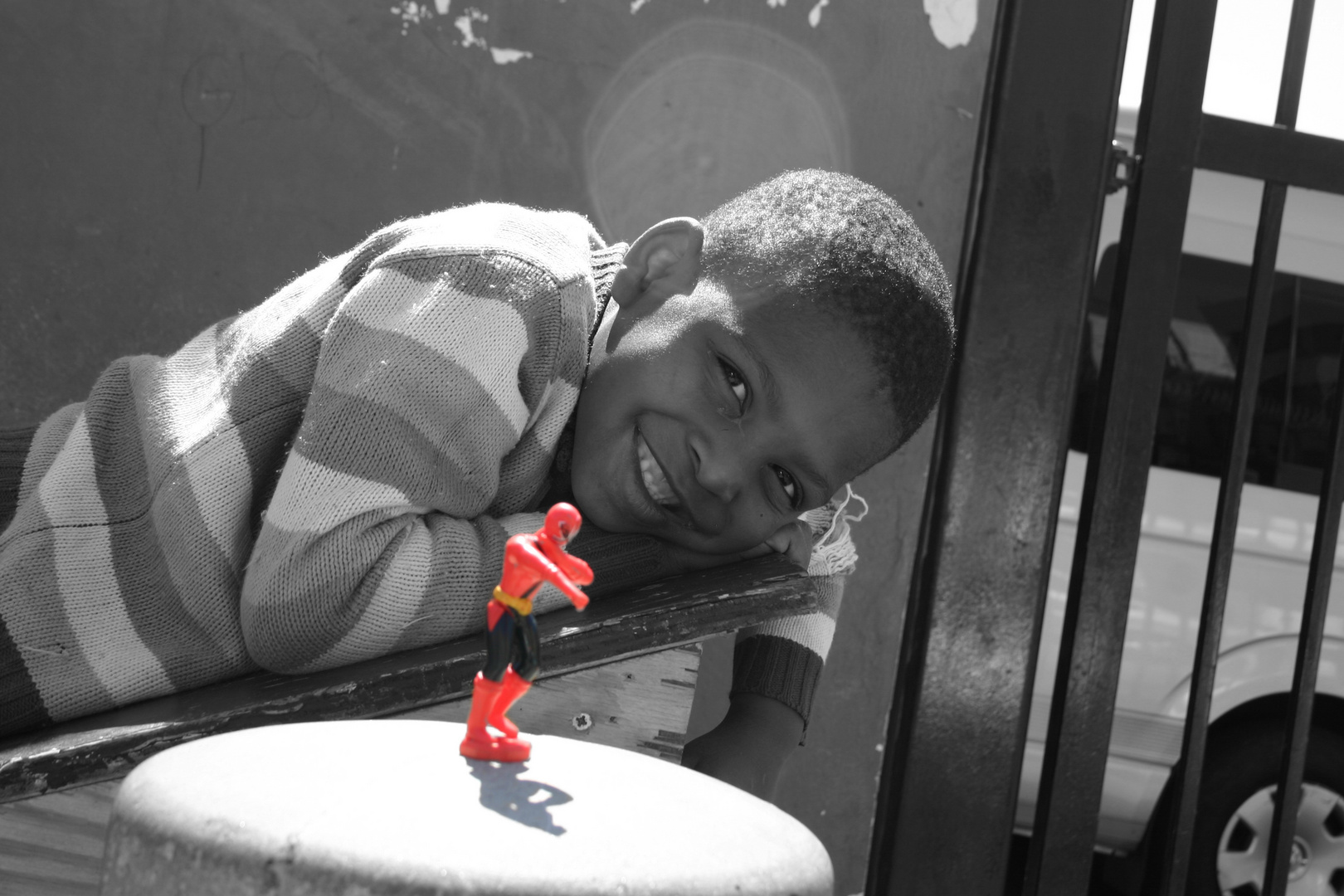 Street Kid With Red Toy