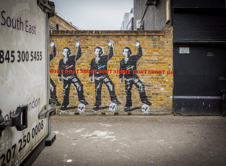 "Streetart in Shoreditch (Rivington Street, London) - PasteUp ""Don't shoot"""