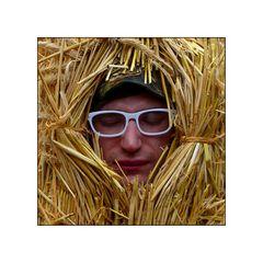 Stroh-Kopf mit Brille