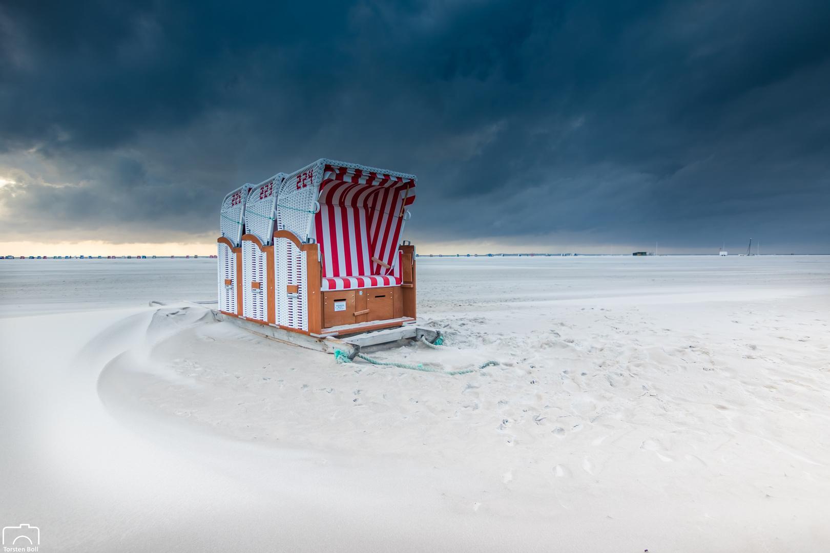 Stürmischer Sonnenuntergang am Strand von Norddorf