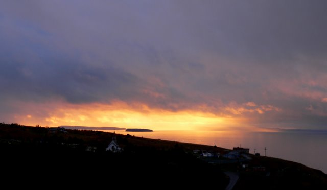 Sun setting over bay