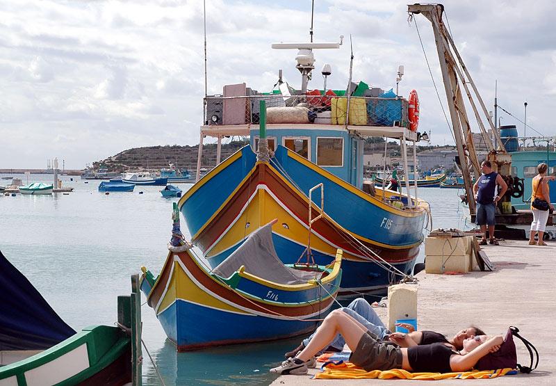 sunbathing in Marsaxlokk