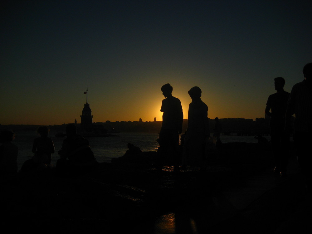 sunset at maiden tower - istanbul - people