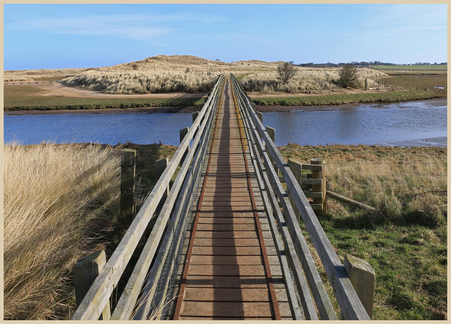 the bridge over the Tughall Burn Beadnell bay