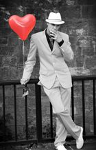 The man with the red balloon