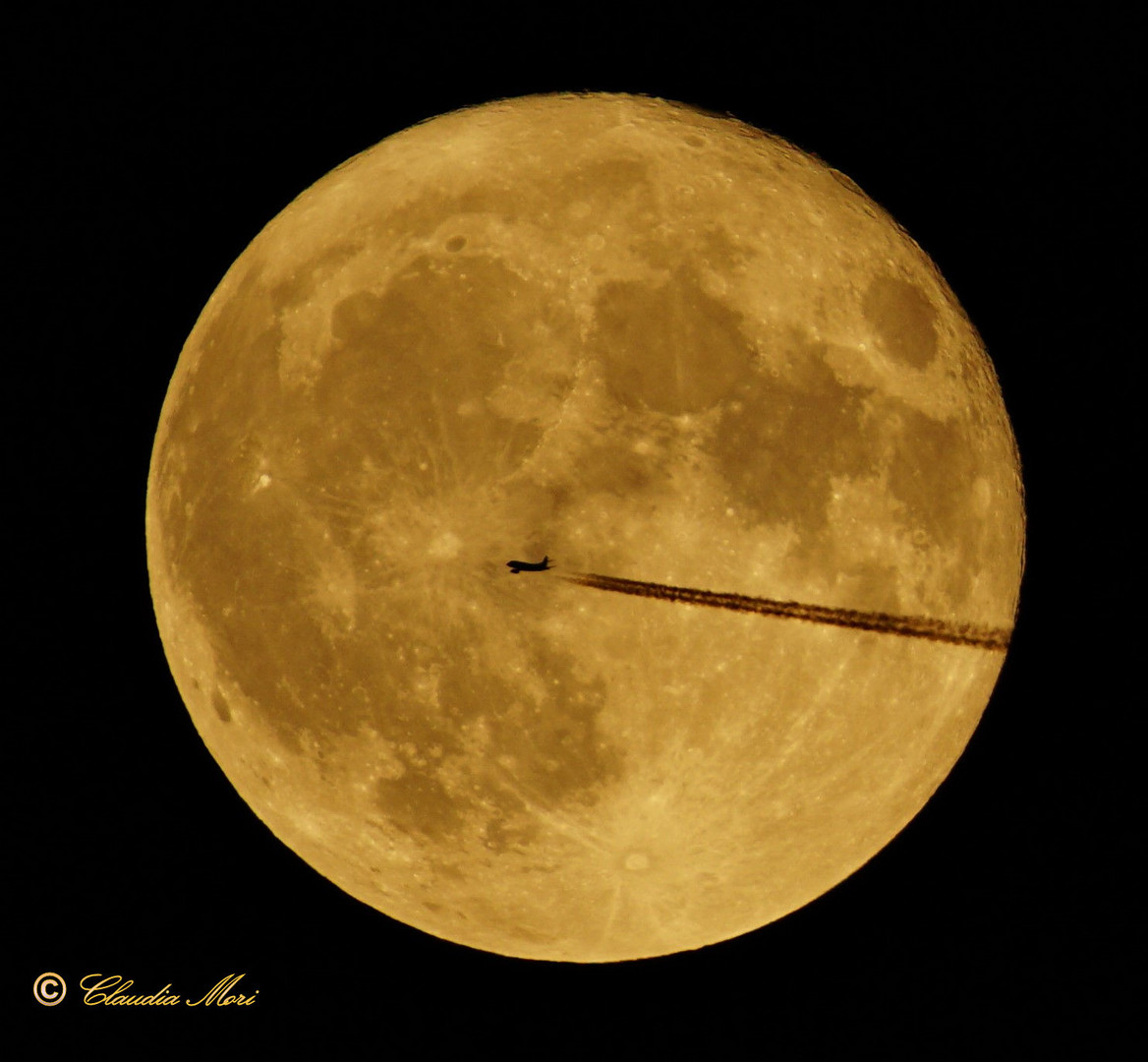 The plane and the full moon