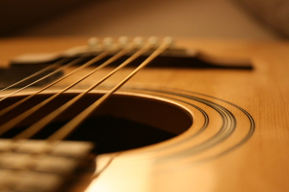 -touch the strings, but cannot touch the sound-