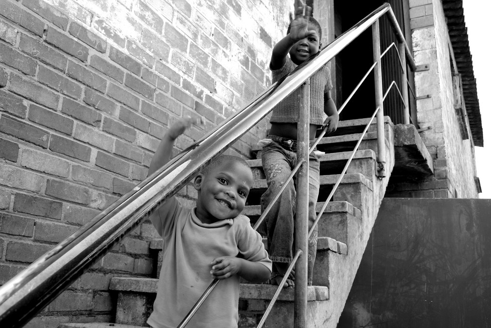Township kids on stairs