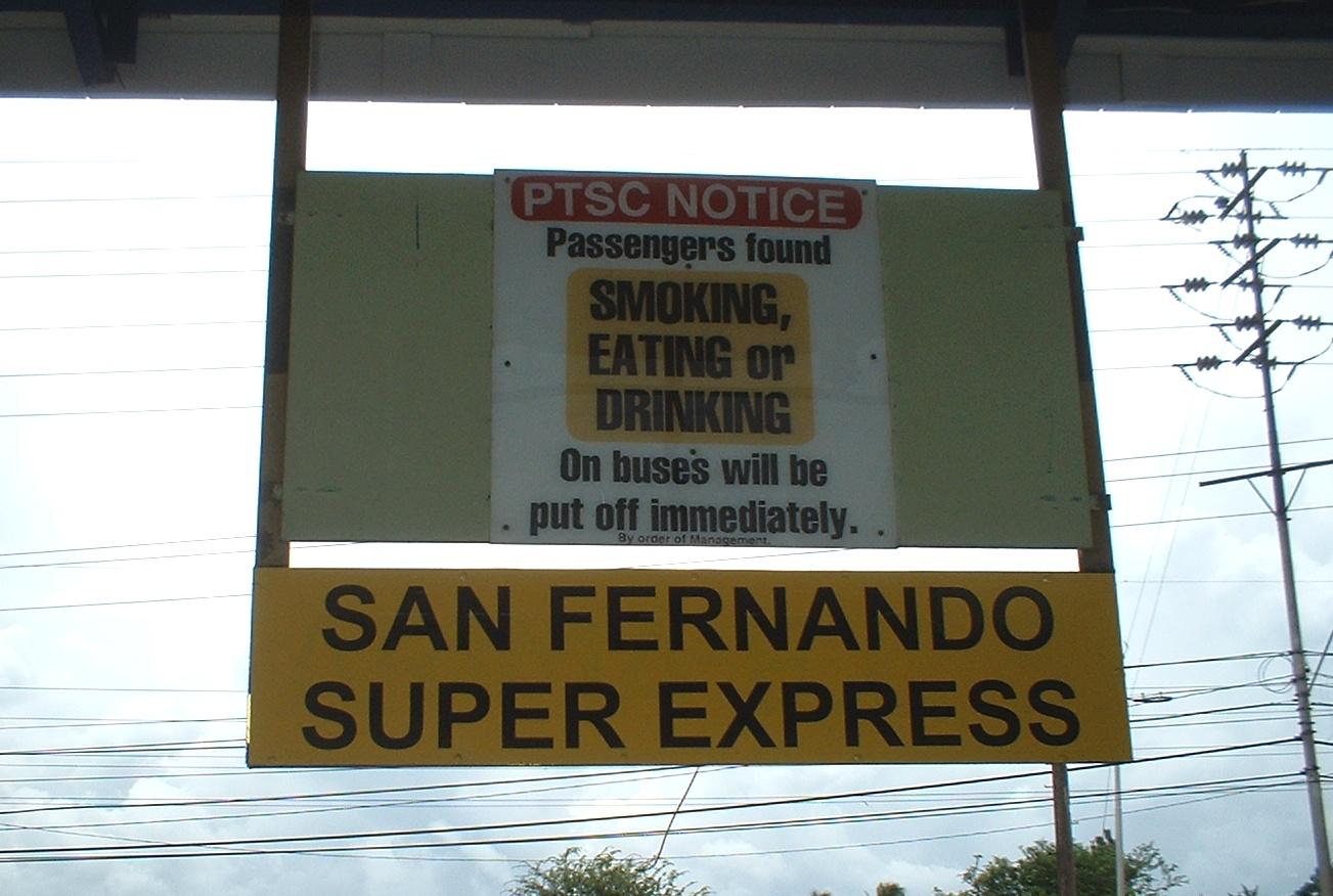 Trinidan; Port of Spain. Notice at bus station