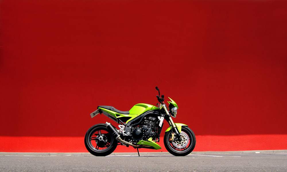 Triumph Speed Triple and the Red Wall...