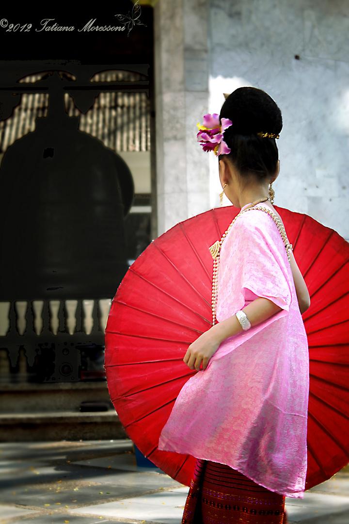 """Turn...Turn...Turn The Little Red Umbrella"" Wat Phrathat, Doi Suthep, Chiang Mai, Thailand."