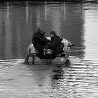 Two fishermen in motor boat