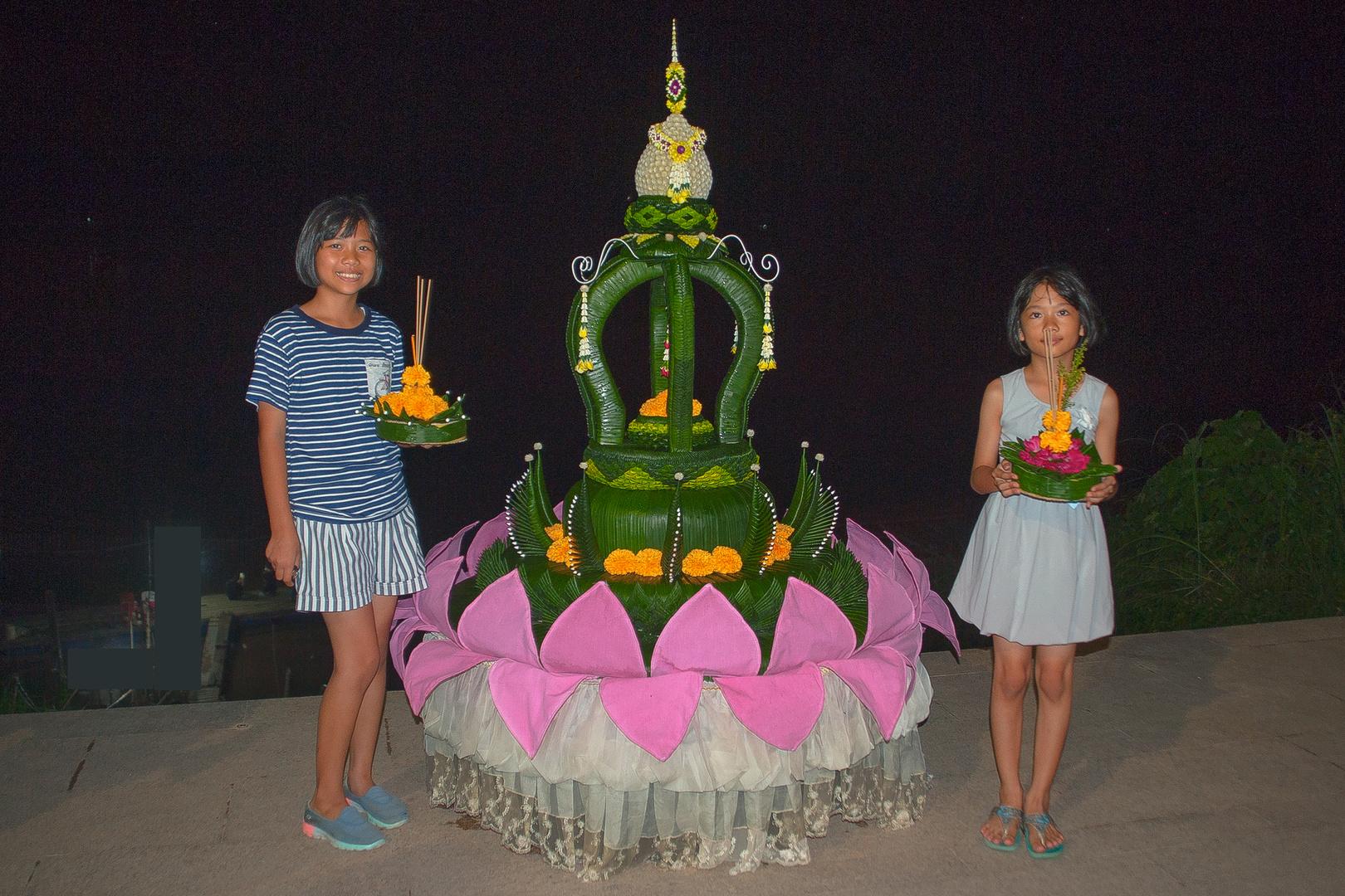 Two girls celebrate Loy Krathong