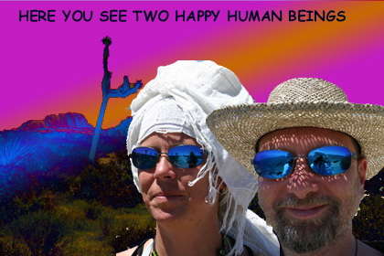 two happy human beings and a joshua tree