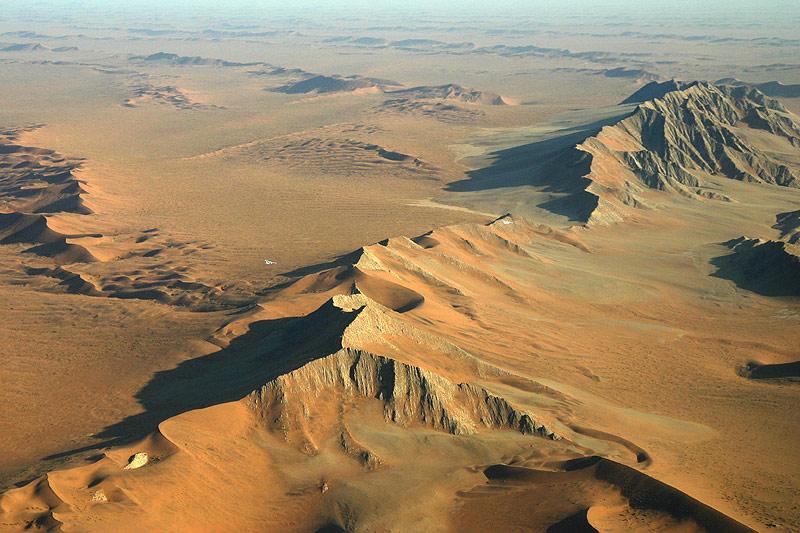 Two little white planes over the Namib Desert