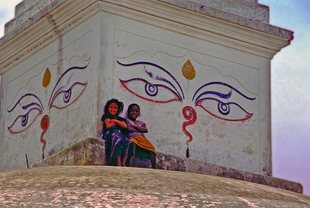 Two lovely girls climb the stupa
