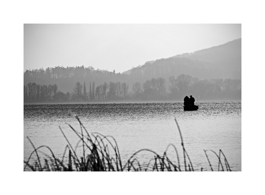 ***two men in a boat***