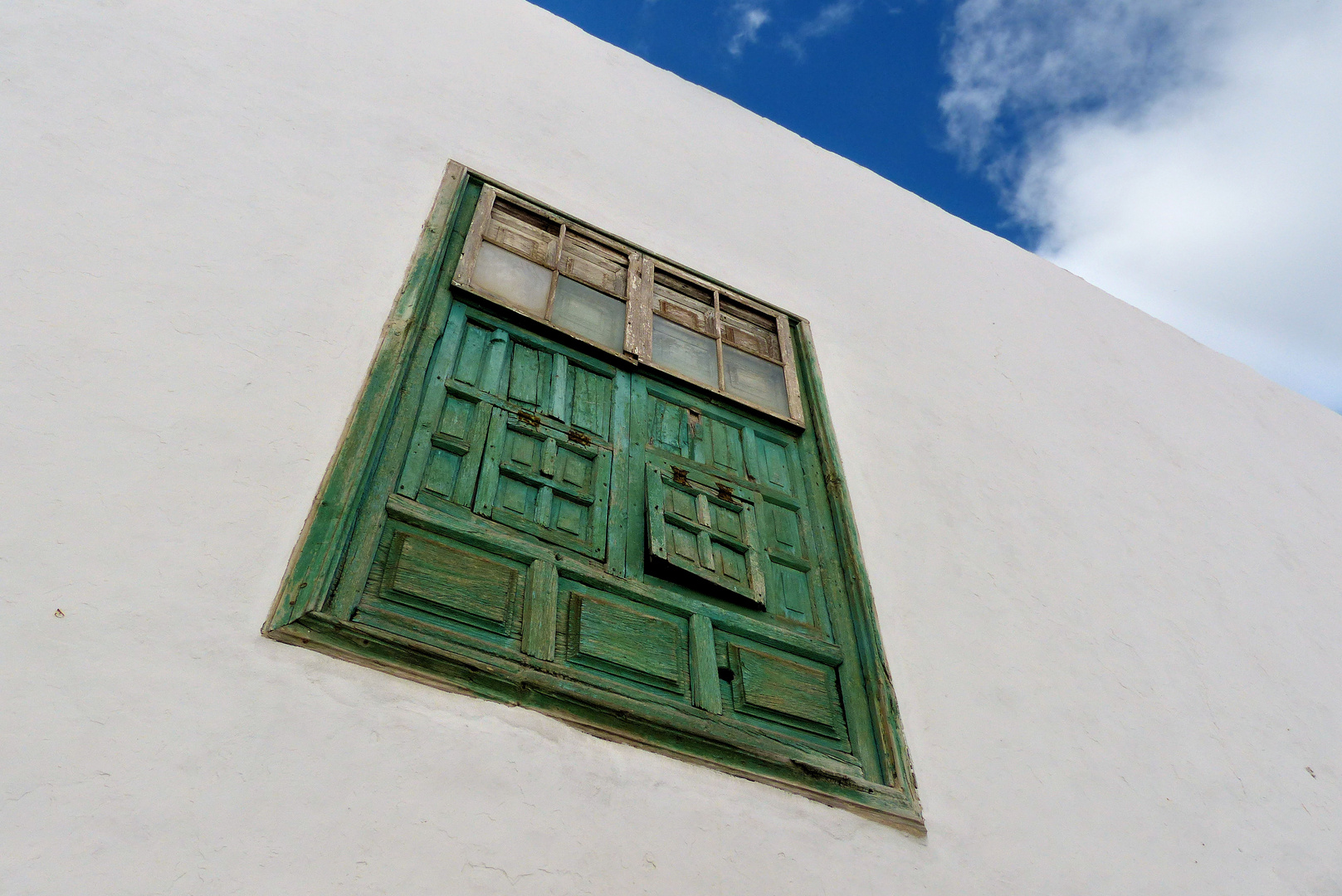 Typical white houses with green windows and doors in Teguise of Lanzarote
