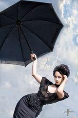 under my umbrella..