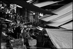 Under the awnings of the market