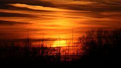 Untergehende Sonnenscheibe