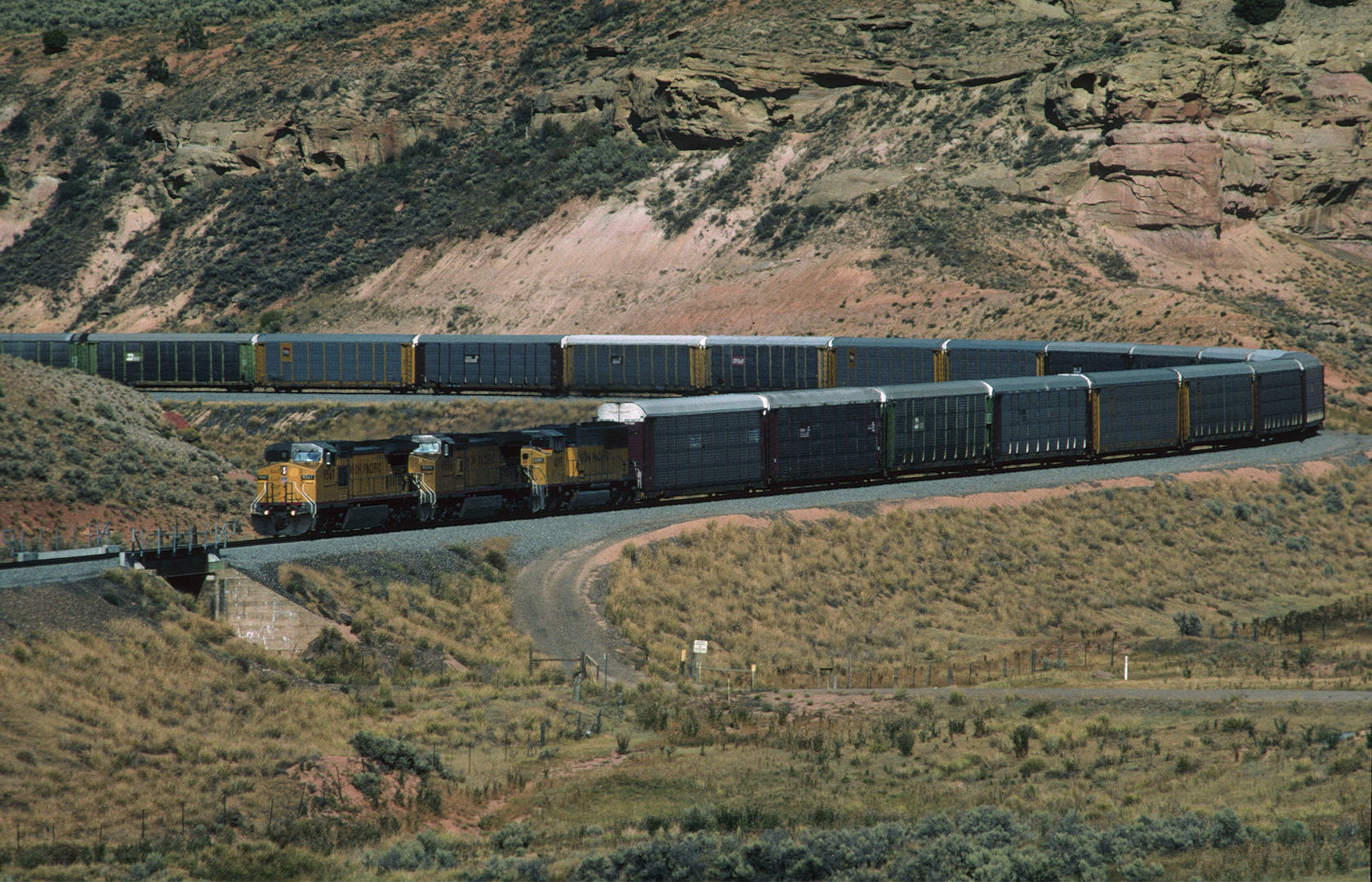 UP#9547 is leading a Train with Enclosed Auto Carrier Gondolas, Echo Canyon,UT