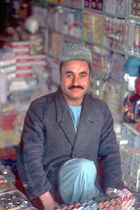 Vendor offers his products in his ordinary shop in Herat