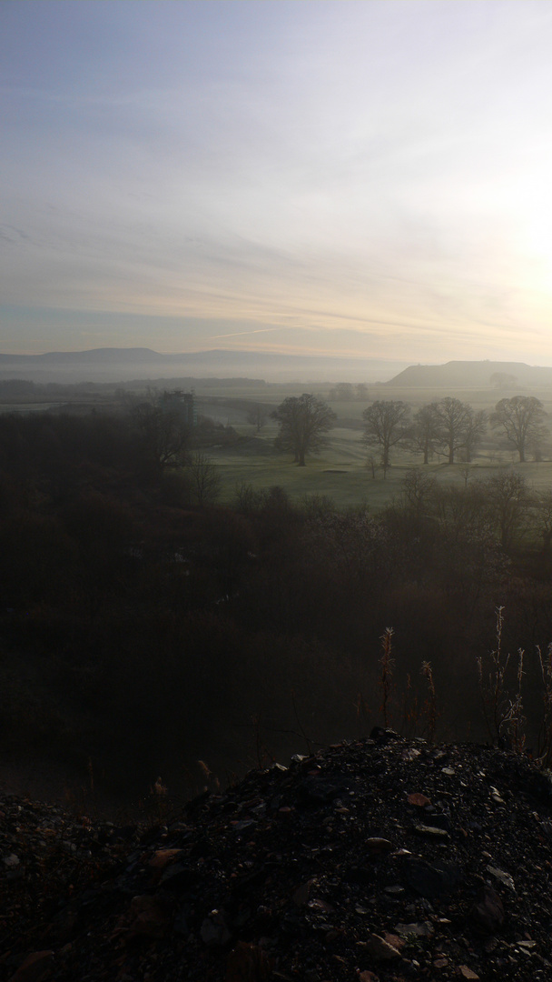 View into the misty landscape from Winchburgh Shale Bing