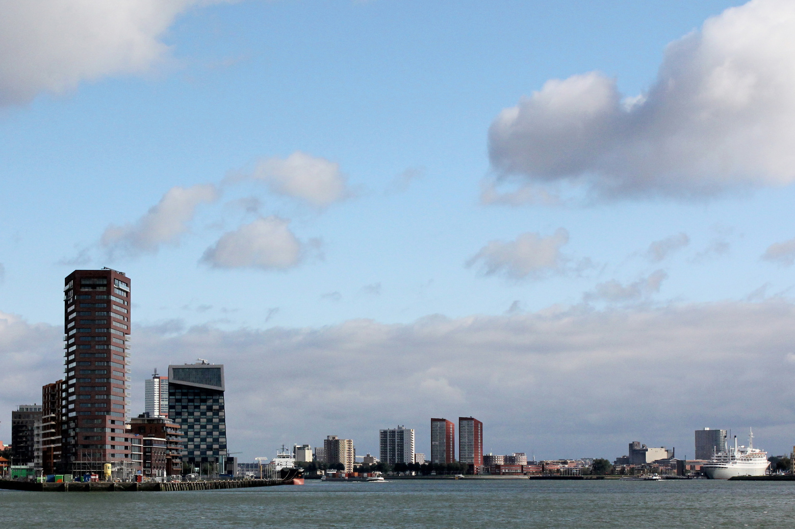 View on the skyline of Rotterdam approaching from sea