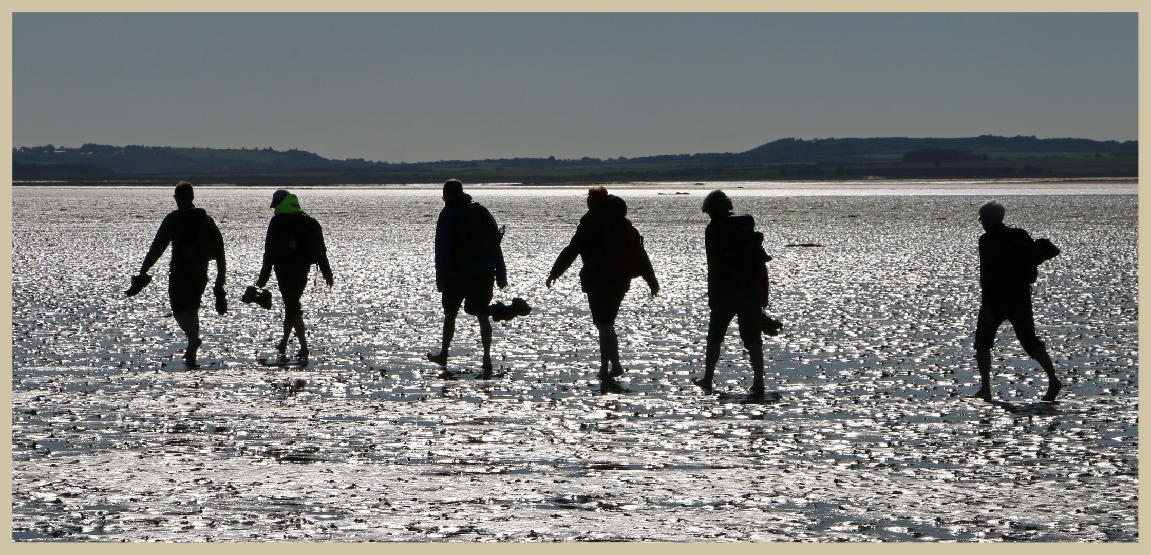 walkers on the pilgrims way Holy island