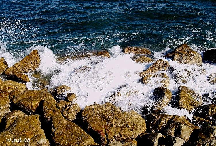 Waves burst in the rocks
