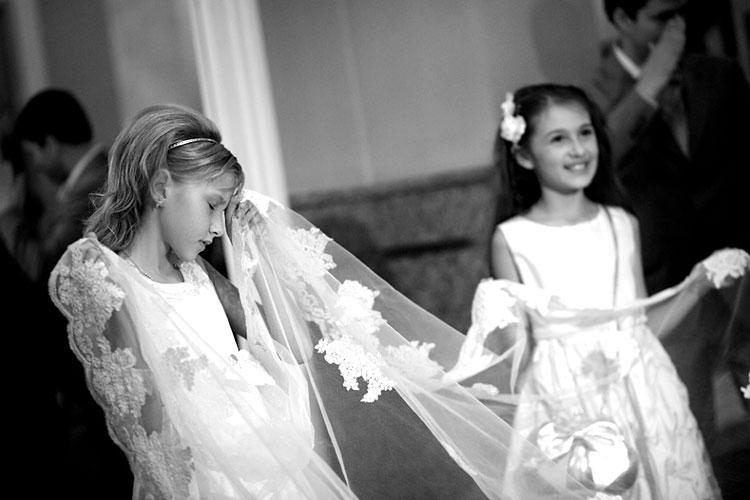 Wedding. Girl holding the veil