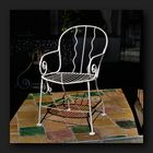 White cast iron chair in the garden house