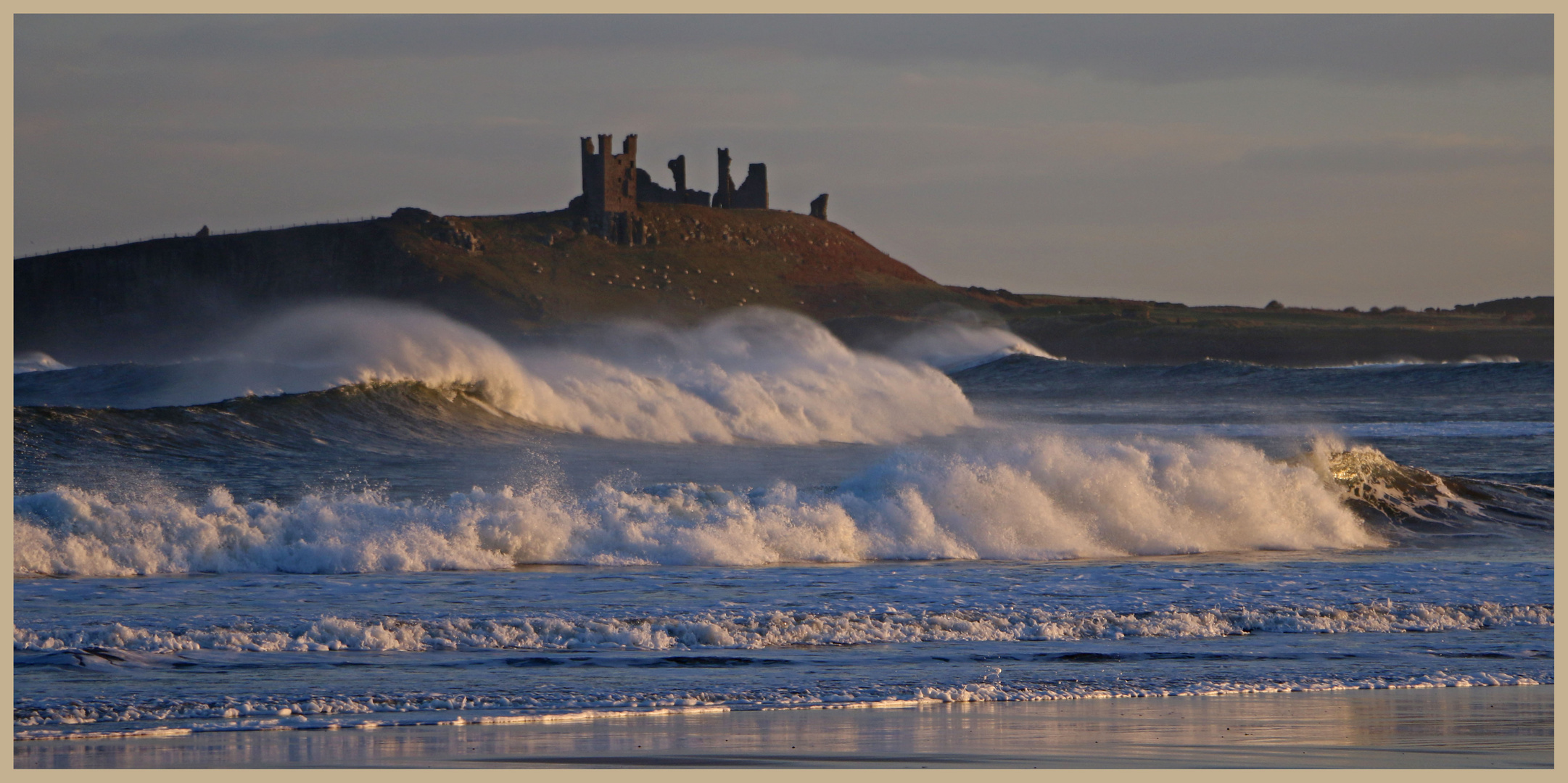 winter waves dunstanburgh castle