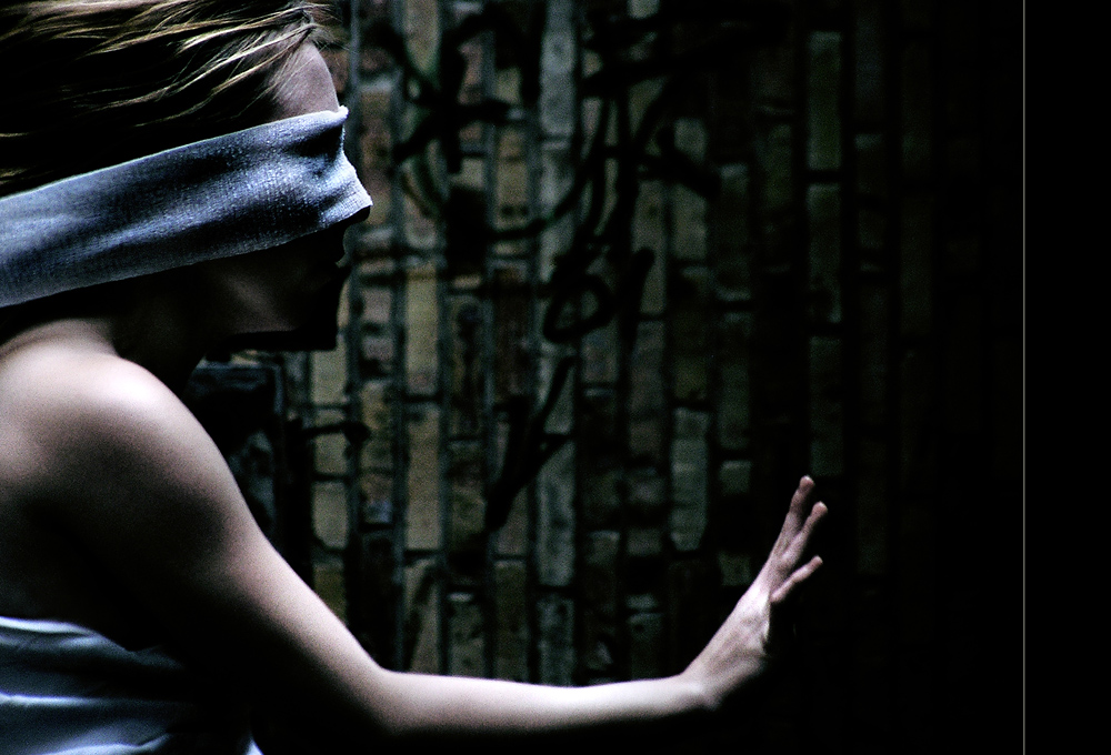 With blindfolded eyes she is just a shadow of herself on our path of lies.